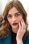 A model prepares backstage ahead of the Burberry Prorsum show during London Fashion Week Spring/Summer 2016 on September 21 2015 in London England