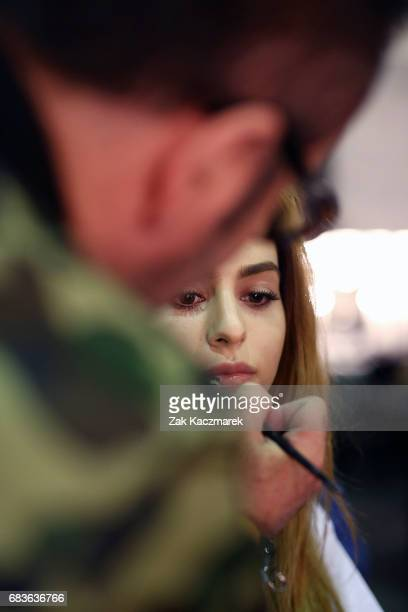 A model prepares backstage ahead of the Christopher Esber show at MercedesBenz Fashion Week Resort 18 Collections at The Clothing Store on May 16...