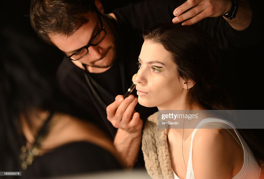 A model prepares backstage ahead of the Ece Gozen show during Mercedes-Benz Fashion Week Istanbul Fall/Winter 2013/14 at Antrepo 3 on March 12, 2013 in Istanbul, Turkey.