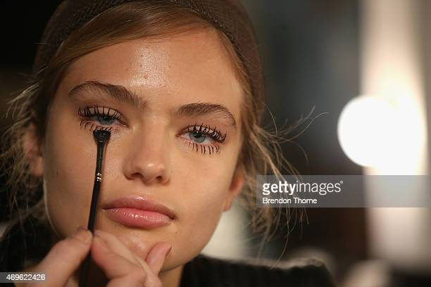 A model prepares backstage ahead of the Ginger Smart show at MercedesBenz Fashion Week Australia 2015 at Carriageworks on April 14 2015 in Sydney...