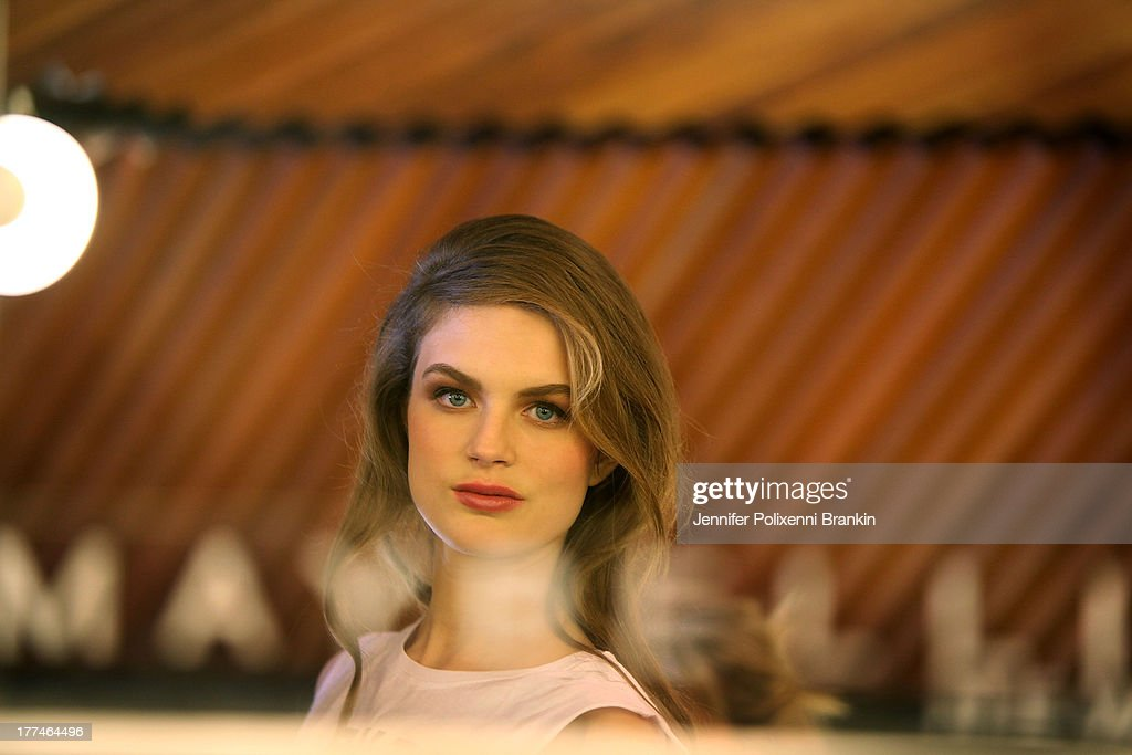 A model prepares backstage ahead of the InStyle Red Carpet Runway show during Mercedes-Benz Fashion Festival Sydney 2013 at Sydney Town Hall on August 23, 2013 in Sydney, Australia.