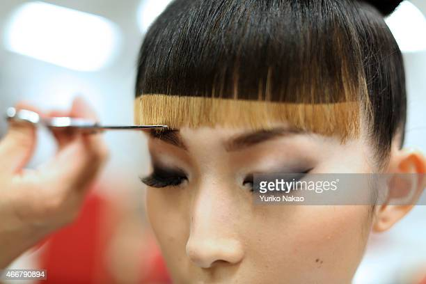 A model prepares backstage ahead of the JOTARO SAITO show as part of Mercedes Benz Fashion Week TOKYO 2015 A/W on March 19 2015 in Tokyo Japan