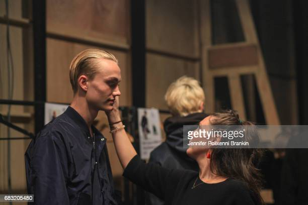 A model prepares backstage ahead of the Justin Cassin show at MercedesBenz Fashion Week Resort 18 Collections at Carriageworks on May 15 2017 in...