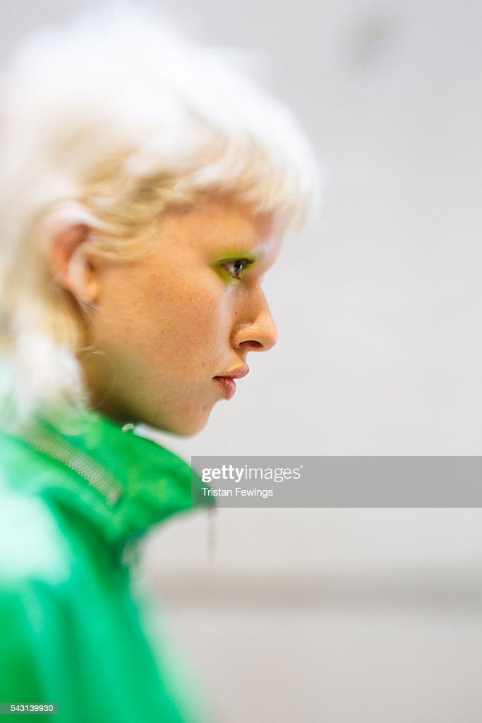 A model prepares backstage ahead of the Kenzo Menswear Spring/Summer 2017 show as part of Paris Fashion Week on June 26, 2016 in Paris, France.