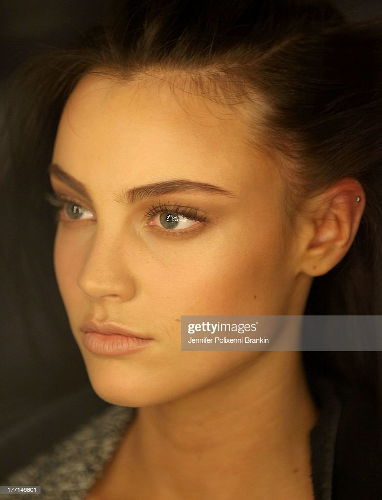 A model prepares backstage ahead of the MBFWA Trends show during Mercedes-Benz Fashion Festival Sydney 2013 at Sydney Town Hall on August 21, 2013 in Sydney, Australia.