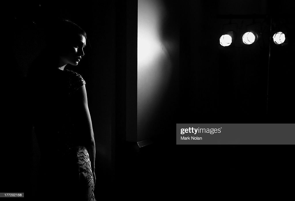 A model prepares backstage ahead of the MBFWA Trends show during Mercedes-Benz Fashion Festival Sydney 2013 at Sydney Town Hall on August 22, 2013 in Sydney, Australia.