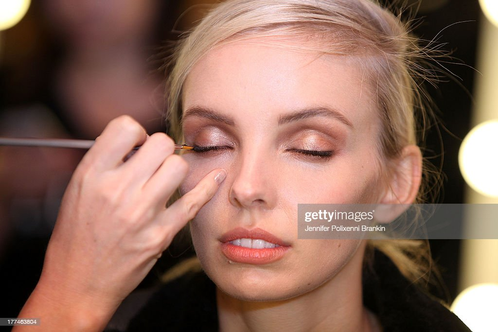A model prepares backstage ahead of the MBFWA Trends show during Mercedes-Benz Fashion Festival Sydney 2013 at Sydney Town Hall on August 23, 2013 in Sydney, Australia.