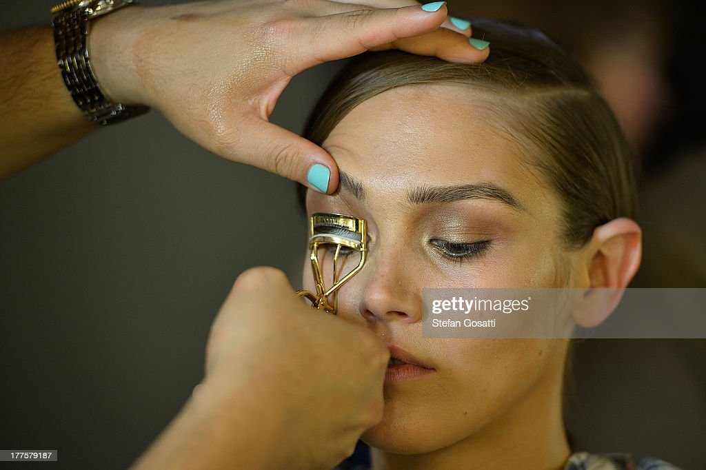 A model prepares backstage ahead of the MBFWA Trends show during Mercedes-Benz Fashion Festival Sydney 2013 at Sydney Town Hall on August 24, 2013 in Sydney, Australia.