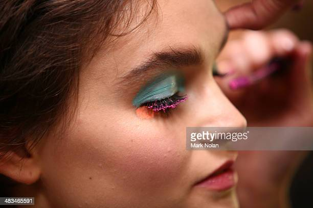 A model prepares backstage ahead of the Raffles show at MercedesBenz Fashion Week Australia 2014 at Carriageworks on April 9 2014 in Sydney Australia