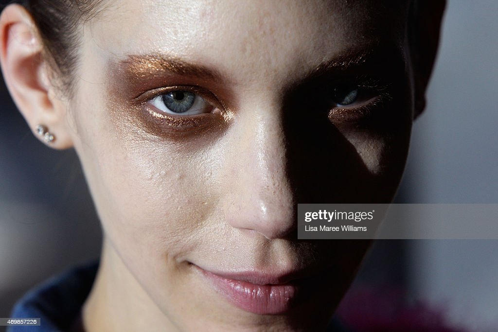 A model prepares backstage ahead of the Romance Was Born show at MercedesBenz Fashion Week Australia 2015 at the Art Gallery of New South Wales on...