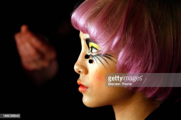 A model prepares backstage ahead of the Romance Was Born show during MercedesBenz Fashion Week Australia Spring/Summer 2013/14 at Carriageworks on...