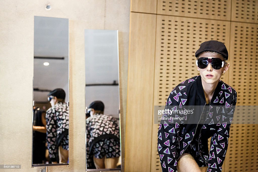A model prepares backstage ahead of the runway during the Kenzo Menswear Spring/Summer 2017 show as part of Paris Fashion Week on June 26, 2016 in Paris, France.