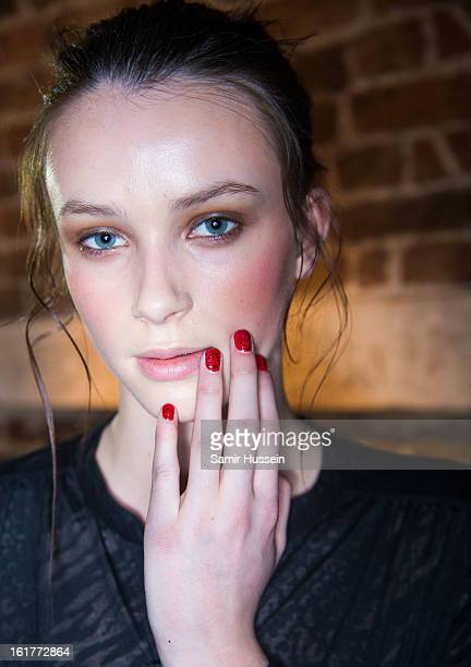 A model prepares backstage ahead of the Sass Bide show during London Fashion Week Fall/Winter 2013/14 at St John's on February 15 2013 in London...