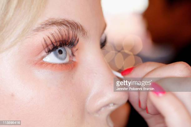 A model prepares backstage ahead of the Shakuhachi show during Rosemount Australian Fashion Week Spring/Summer 2011/12 at Overseas Passenger Terminal...