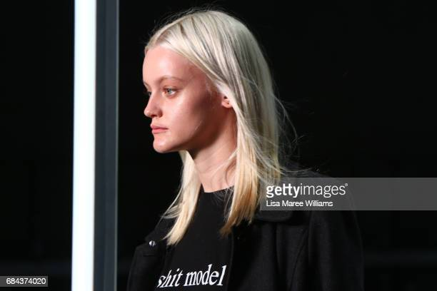 A model prepares backstage ahead of the StrateasCarlucci show at MercedesBenz Fashion Week Resort 18 Collections at Carriageworks on May 18 2017 in...