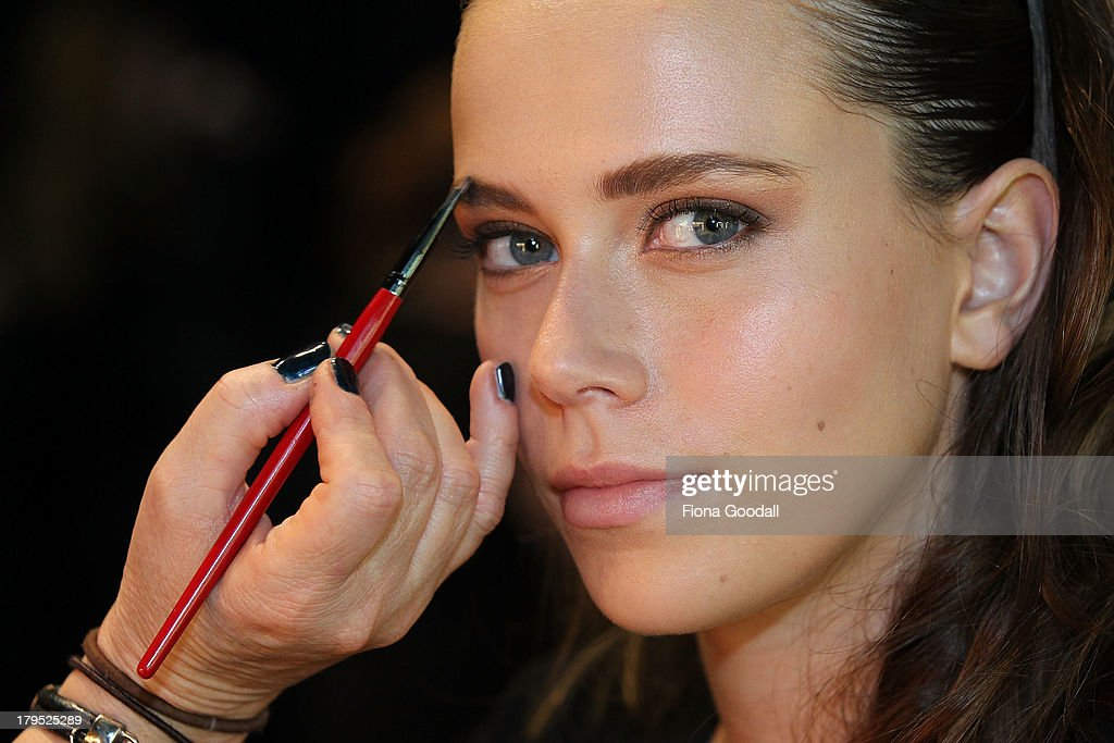 A model prepares backstage ahead of the Tiger Lilly show during New Zealand Fashion Week at the Viaduct Events Centre on September 5, 2013 in Auckland, New Zealand.