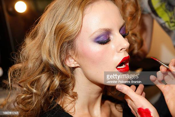 A model prepares backstage ahead of the We Are Handsome show during MercedesBenz Fashion Week Australia Spring/Summer 2013/14 at Carriageworks on...