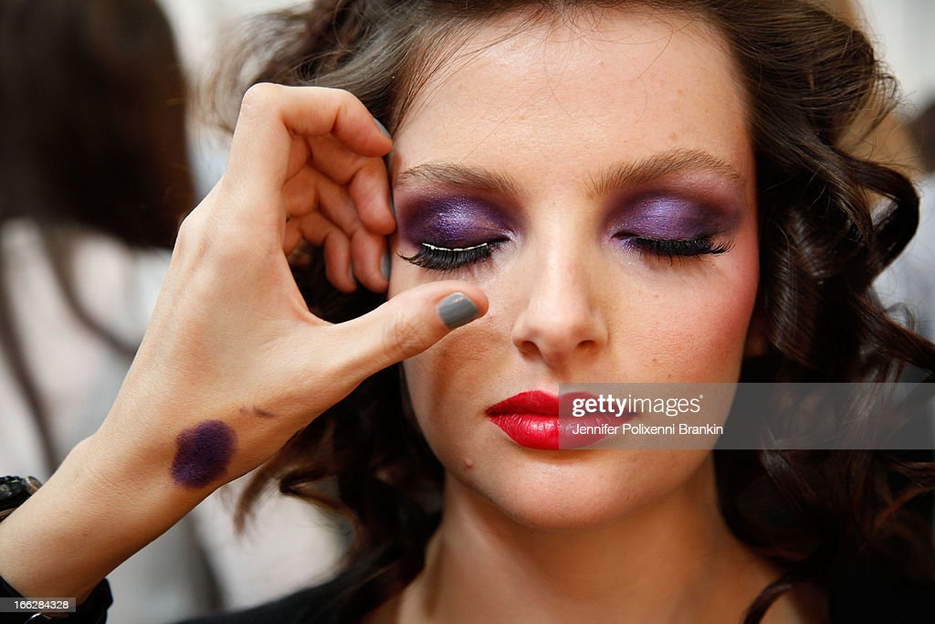 A model prepares backstage ahead of the We Are Handsome show during Mercedes-Benz Fashion Week Australia Spring/Summer 2013/14 at Carriageworks on April 10, 2013 in Sydney, Australia.