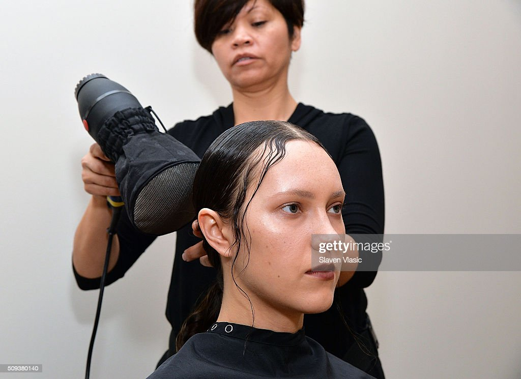 A model prepares backstage at Haus Alkire Presentation during Fall 2016 New York Fashion Week on February 10, 2016 in New York City.