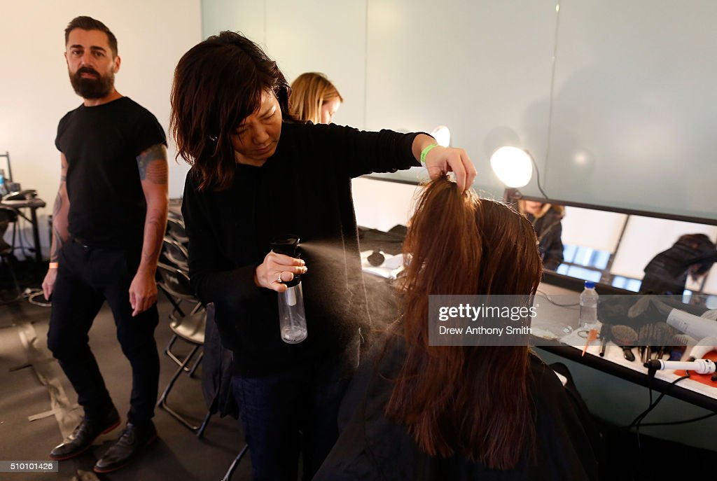 A model prepares backstage at Kerastase Paris at Altuzarra F/W 2016 Show at Spring Studios on February 13, 2016 in New York City.