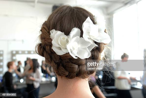 A model prepares backstage at Marchesa Bridal Fall/Winter 2016 presentation at Canoe Studios on October 8 2015 in New York City