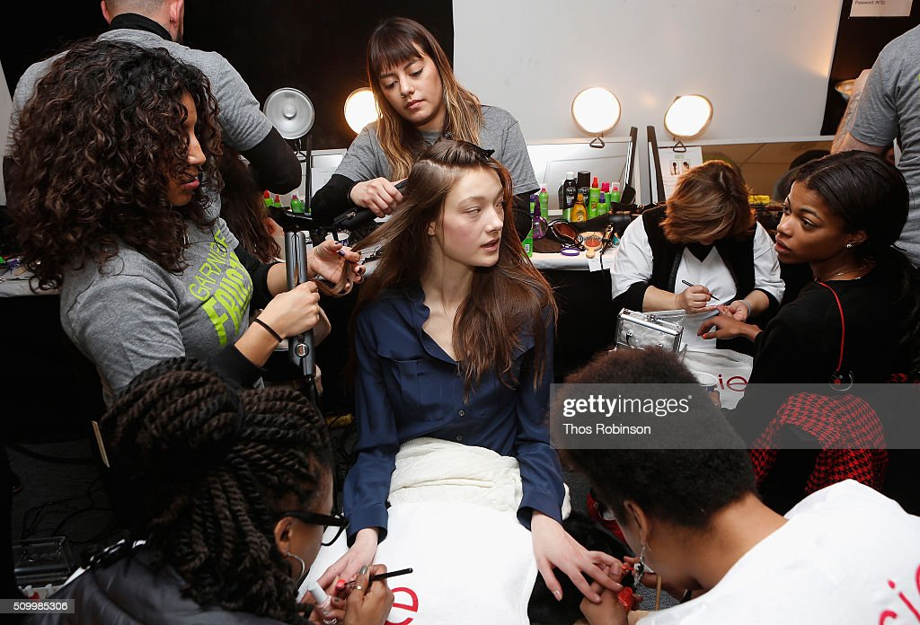 A model prepares backstage at Rebecca Minkoff Fall 2016 sponsored by Garnier Hair at the #SEEBUYWEAR Runway Show at The Gallery, Skylight at Clarkson Sq on February 13, 2016 in New York City.