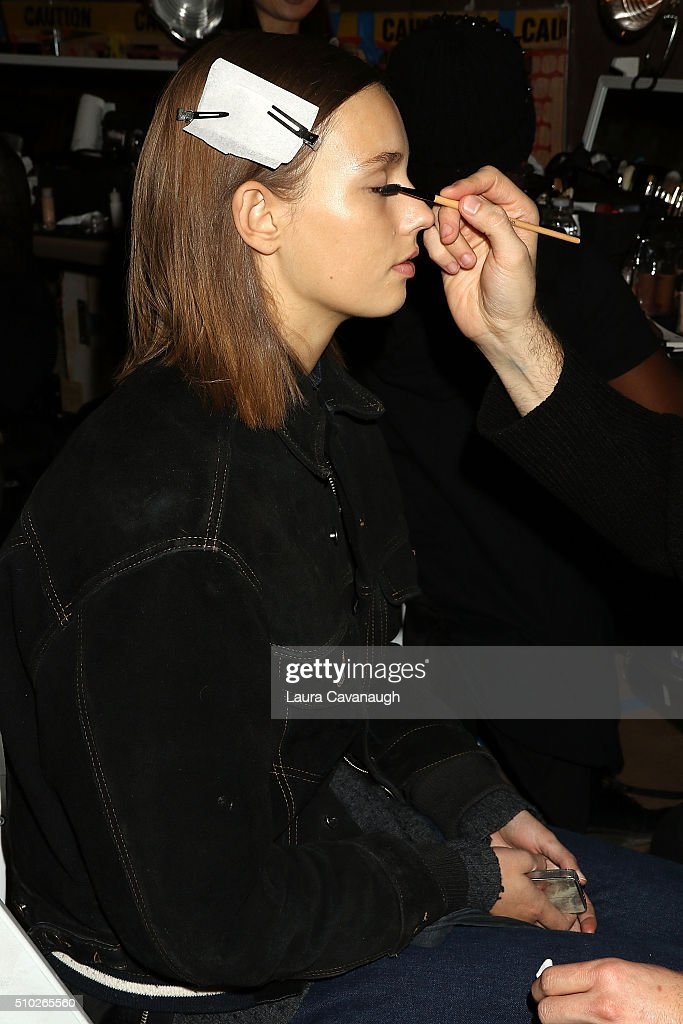 A model prepares backstage at Sies Marjan - Backstage - Fall 2016 New York Fashion Week at Ralph Walker Tribeca on February 14, 2016 in New York City.