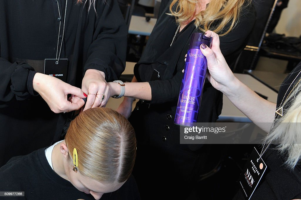 A model prepares backstage at Suno F/W 2016 with Kerastase Paris at Pier 59 on February 13, 2016 in New York City.