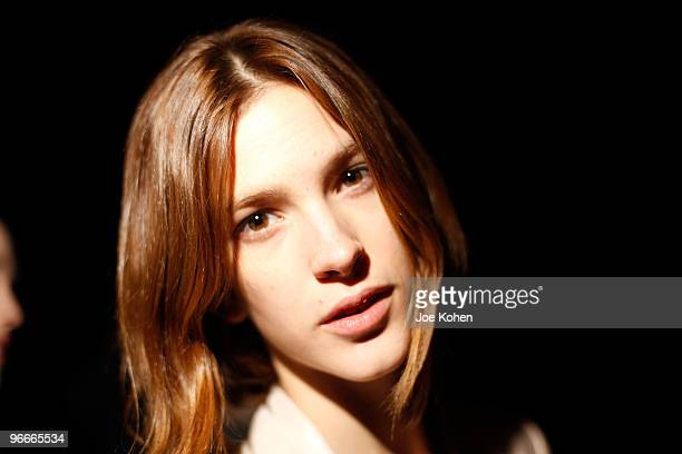 A model prepares backstage at the Academy of Art University Fall 2010 fashion show during MercedesBenz Fashion Week at The Tent at Bryant Park on...