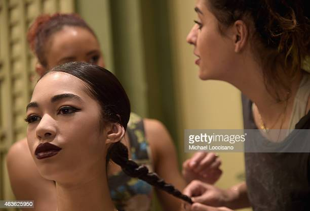 A model prepares backstage at the alice olivia by Stacey Bendet fashion show during MercedesBenz Fashion Week Fall 2015 on February 16 2015 in New...