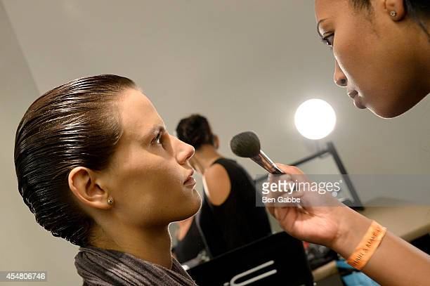 A model prepares backstage at the Altuzarra fashion show during MercedesBenz Fashion Week Spring 2015 at Spring Studios on September 6 2014 in New...