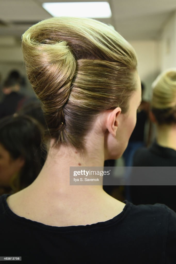 A model prepares backstage at the B Michael America fashion show during MercedesBenz Fashion Week Fall 2015 at New York Public Library on February 18...