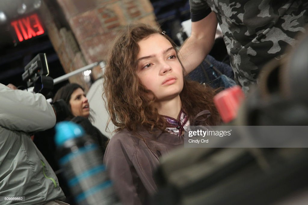 A model prepares backstage at the BCBGMAXAZRIA Fall 2016 fashion show during New York Fashion Week: The Shows at The Dock, Skylight at Moynihan Station on February 11, 2016 in New York City.