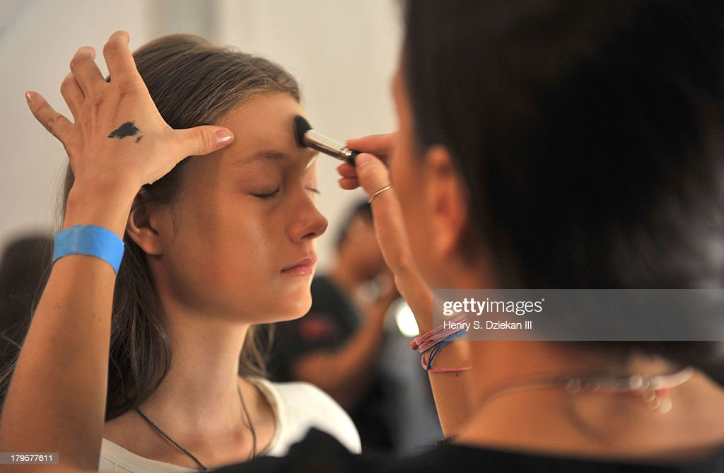 A model prepares backstage at the BCBGMAXAZRIA show during Spring 2014 Mercedes-Benz Fashion Week at The Theatre at Lincoln Center on September 5, 2013 in New York City.