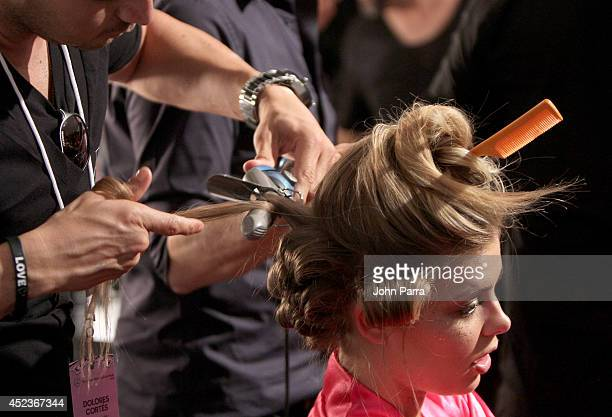A model prepares backstage at the Beach Bunny Featuring The Blonds show during MercedesBenz Fashion Week Swim 2015 at Cabana Grande at The Raleigh on...