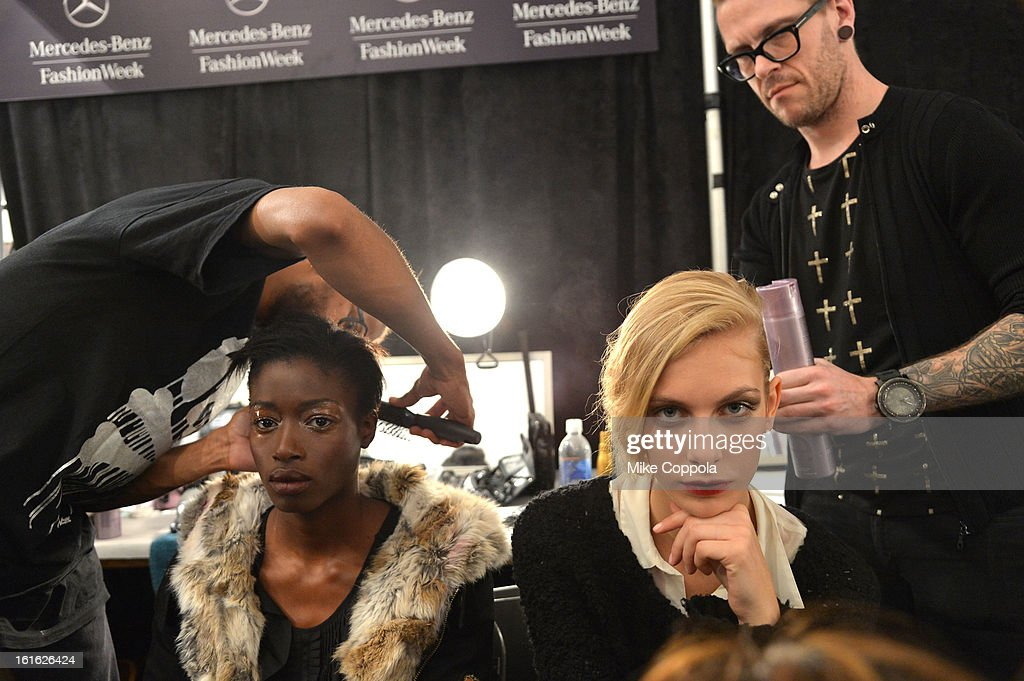 A model prepares backstage at the Bibhu Mohapatra Fall 2013 fashion show during Mercedes-Benz Fashion Week at The Studio at Lincoln Center on February 13, 2013 in New York City.