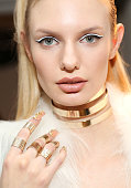 A model prepares backstage at The Blonds fashion show during MADE Fashion Week Fall 2015 at Milk Studios on February 18 2015 in New York City