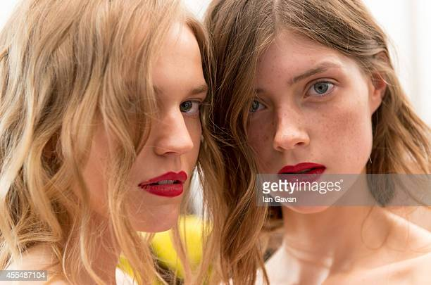 A model prepares backstage at the Burberry Prorsum show during London Fashion Week Spring Summer 2015 on September 15 2014 in London England