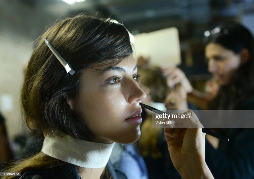 A model prepares backstage at the Chadwick Bell fashion show during Mercedes-Benz Fashion Week Spring 2014 at Hosfelt Gallery on September 6, 2013 in New York City.