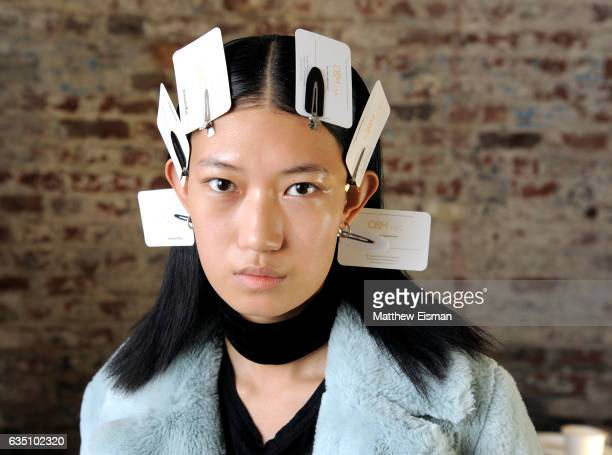 A model prepares backstage at the Christopher Esber presentation during New York Fashion Show on February 13 2017 in New York City