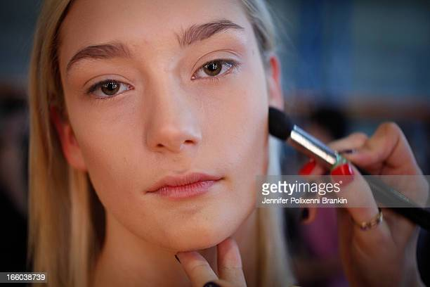 A model prepares backstage at the Christopher Esber show during MercedesBenz Fashion Week Australia Spring/Summer 2013/14 at 10 Carrington Rd...