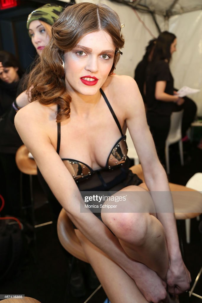A model prepares backstage at the Chromat fashion show during MADE Fashion Week Fall 2014 at The Standard Hotel on February 6, 2014 in New York City.