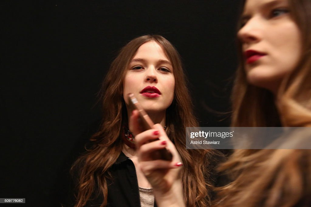 A model prepares backstage at the Concept Korea Fall 2016 fashion show during New York Fashion Week: The Shows at The Dock, Skylight at Moynihan Station on February 12, 2016 in New York City.