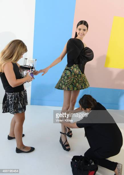A model prepares backstage at the Delpozo fashion show during MercedesBenz Fashion Week Spring 2015 at Location 05 Studios on September 10 2014 in...