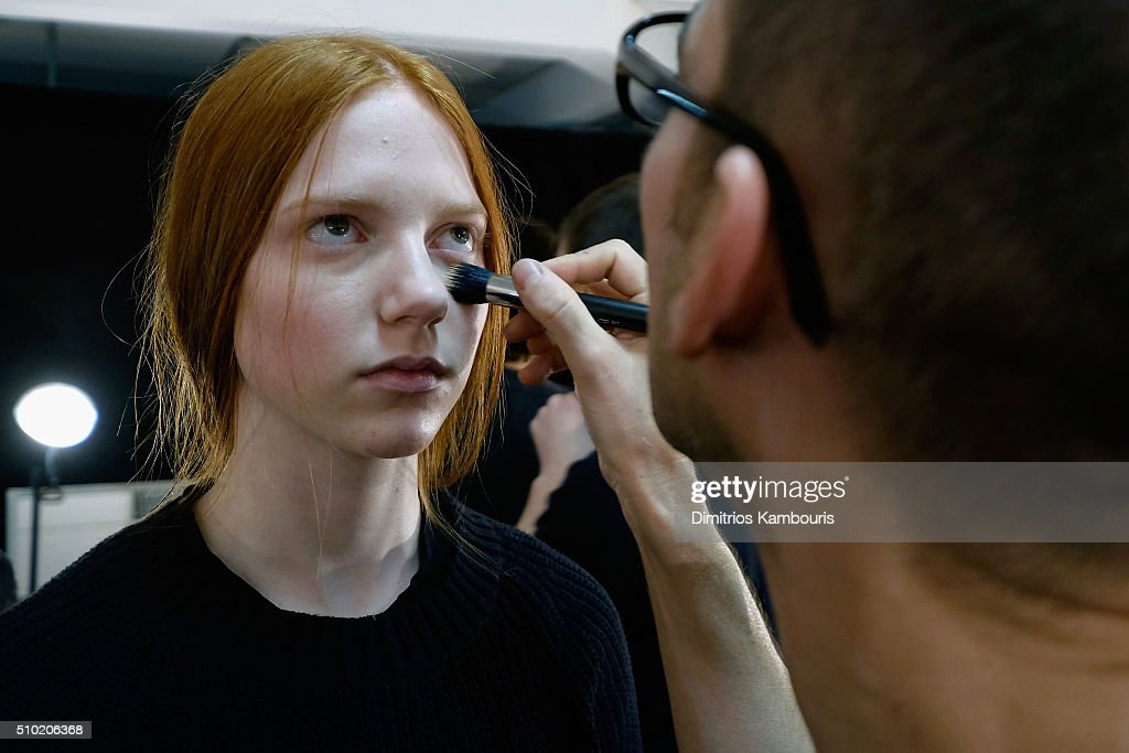 A model prepares backstage at the Derek Lam Fall 2016 fashion show during New York Fashion Week: The Shows at The Gallery, Skylight at Clarkson Sq on February 14, 2016 in New York City.