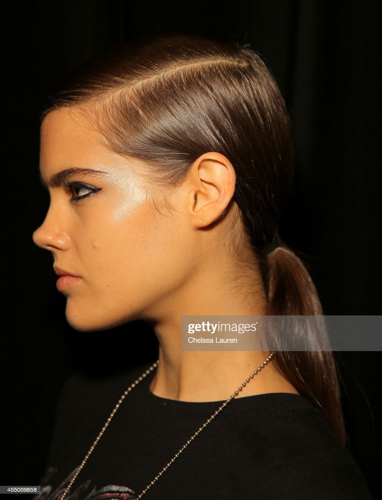 A model prepares backstage at the Diesel Black Gold fashion show during MercedesBenz Fashion Week Spring 2015 at Skylight at Moynihan Station on...