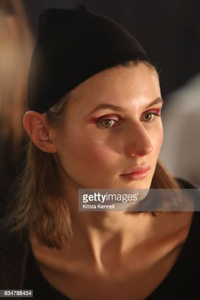 A model prepares backstage at the Dion Lee runway show during New York Fashion Week The Shows at Skylight Clarkson Sq on February 11 2017 in New York...