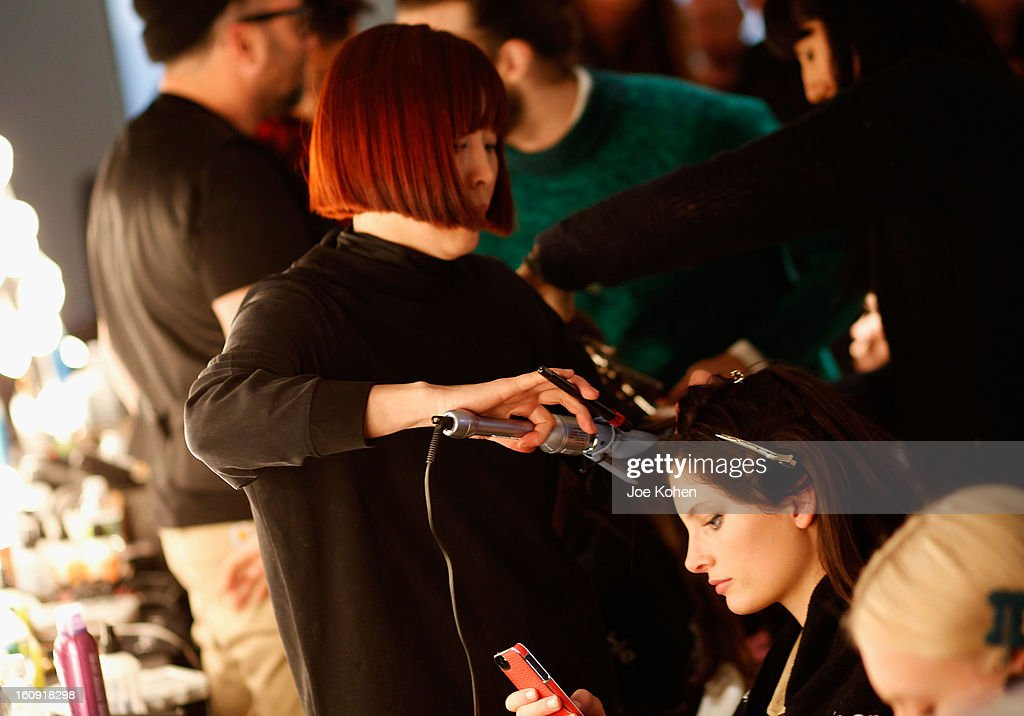 A model prepares backstage at the Edun Fall 2013 fashion show during Mercedes-Benz Fashion Week at Skylight West on February 7, 2013 in New York City.