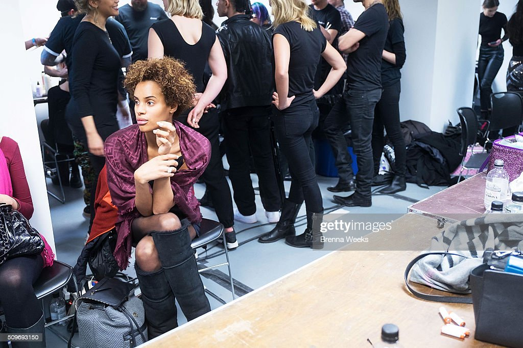 A model prepares backstage at the Ev Bessar 'Firebird' Fall 2016 Fashion Show at Gotham Hall on February 11, 2016 in New York City.