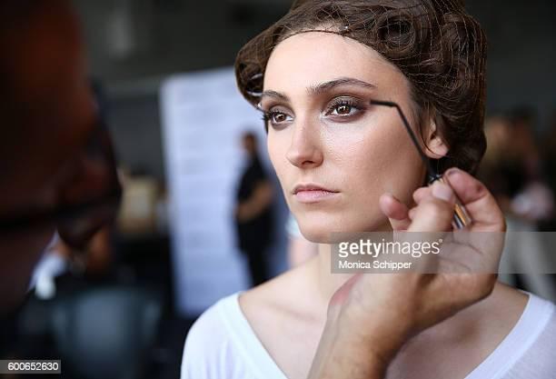 A model prepares backstage at the Fashion Palette Australian Swim/Resort fashion show during New York Fashion Week September 2016 at Pier 59 Studios...